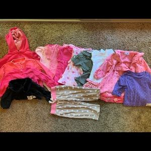 A bunch of baby girl cloth